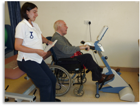 A patient benefitting from using the Passive Therapy Bicycle, another recent purchase for the Physiotherapy Dept.