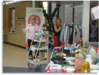 Some of our volunteers preparing a stall for the Christmas Fayre